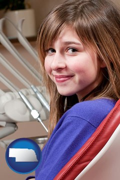 a smiling dental clinic patient - with Nebraska icon