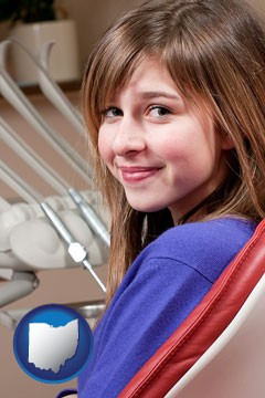 a smiling dental clinic patient - with Ohio icon