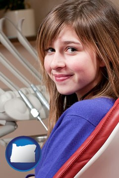 a smiling dental clinic patient - with Oregon icon