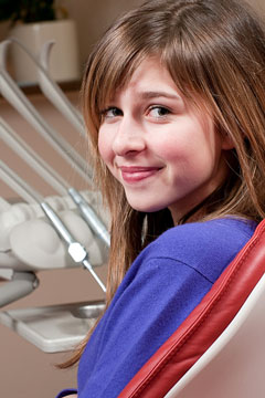 a smiling dental clinic patient